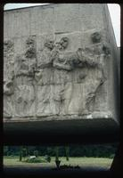 Chelmno Concentration Camp : Close-up of memorial bas-relief and memorial flame