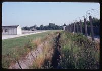 "Dachau Concentration Camp : Camp wall, fencing and ""kill zone"" near Catholic Chapel"