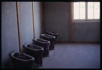 Dachau Concentration Camp : Rebuilt toilets in barracks bathroom