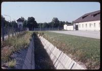 Dachau Concentration Camp : Wall, ditch and fencing near camp's main tourist entry gate