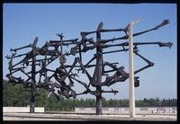 Dachau Concentration Camp : View through memorial sculpture to barracks complex