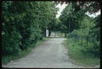 Belzec Concentration Camp : Main tourist memorial entry gate from tourist parking lot