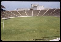 "View from lower end zone stands into the Cotton Bowl, with no Field markings, and ""improper cutting"", 1952"
