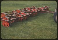 A 7 gang Toro Roughmaster mower with noisy, studded steel wheels, 1954